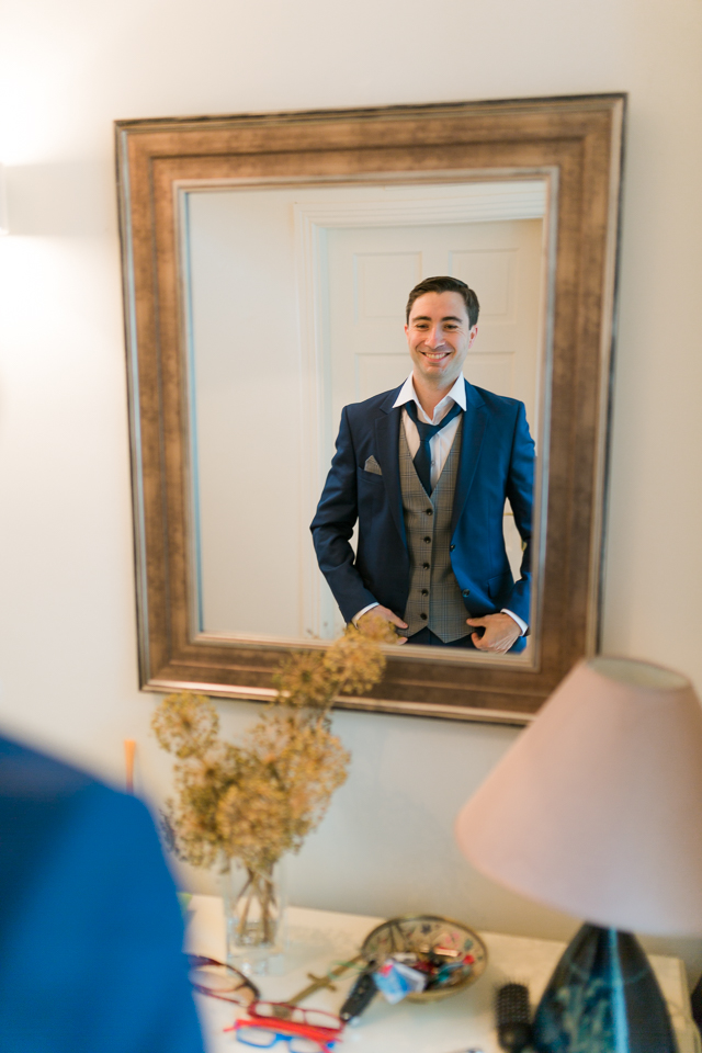 groom in mirror, getting ready, wedding day, wedding ceremony