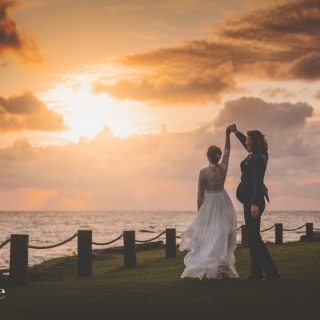Bride and groom dancing at sunset at the Armada Hotel